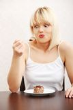 Portrait woman eating piece of cake royalty free stock images