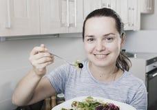Portrait woman eating salad Royalty Free Stock Photo