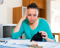 Portrait of woman with empty wallet. Portrait of young unhappy businesswoman with empty wallet Stock Image