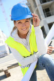 Portrait of woman engineer with blue helmet Stock Images