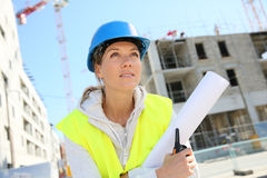 Portrait of woman engineer holding blueprint Royalty Free Stock Image