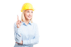 Portrait of woman engineer making idea gesture Stock Photo