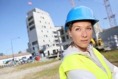 Portrait of woman engineer beside new buildings Royalty Free Stock Image