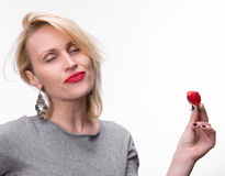 Portrait of a woman enjoying eating strawberries Stock Photos