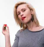 Portrait of a woman enjoying eating strawberries Royalty Free Stock Photo