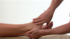 Portrait of a woman enjoying a foot massage