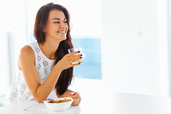 Portrait of woman enjoying her morning meal. Healthy eating. Hea Stock Photography