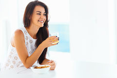 Portrait of woman enjoying her morning meal. Healthy eating. Hea royalty free stock image