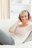 Portrait of a woman enjoying some music. While looking at the camera Royalty Free Stock Image