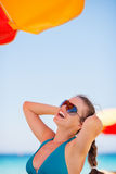 Portrait of woman enjoying vacation on beach Stock Images