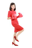 Portrait of woman excited with red boxing gloves Royalty Free Stock Photo