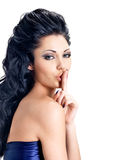 Portrait of woman with  expression silent. Photo of brunette girl with finger near lips, concept of silence Stock Image