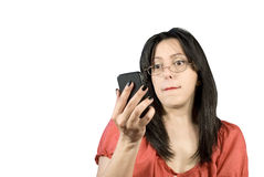 Portrait of woman with eye glasses having trouble seeing cell phone Royalty Free Stock Images