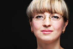 Portrait of the woman in eyeglasses close up Stock Images
