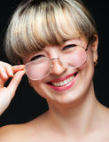 Portrait of the woman in eyeglasses close up Stock Photography