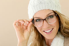 Portrait of woman with eyeglasses and winter hat. Portrait of mature woman with hat and eyeglasses Stock Photos