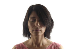 Portrait of a woman with eyes closed on white. Background royalty free stock image