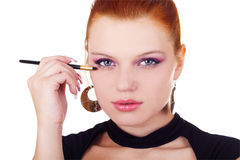 Portrait of woman with eyshadow brush Royalty Free Stock Photography