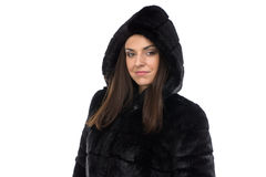 Portrait of woman in fake fur coat with hood Royalty Free Stock Images