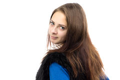 Portrait of woman in fake fur waistcoat from back Stock Photo