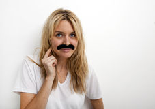 Portrait of woman in fake mustache against white background royalty free stock photo