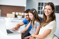 Portrait of woman with family using laptop Royalty Free Stock Photo