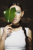 Portrait of woman with fashion make up with blue eye and leaf on Royalty Free Stock Photography