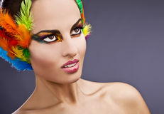 Fashion model with feathers Stock Images