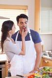 Portrait a woman feeding her husband Stock Photos