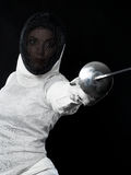 Portrait of woman fencer. Holding rapier. Olympic sports, martial arts, attack and professional training concept Stock Photos