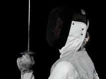 Portrait of woman fencer. Holding rapier. Olympic sports, martial arts, attack and professional training concept Royalty Free Stock Photography