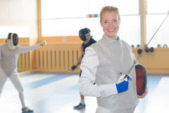 Portrait woman in fencing clothing Royalty Free Stock Photography