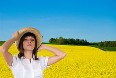 Portrait of woman in  field. Portrait of attractive young woman in straw hat in  a  field of oil seed rape Stock Photos