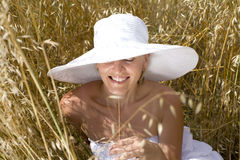 Portrait of woman in field wearing white hat Stock Image