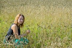 Portrait of woman in field Stock Photo