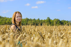 Portrait of woman in field Stock Images
