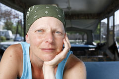Portrait of a woman fighting breast cancer wearing a bandana. Stock Photo