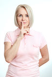 Portrait  woman with finger on lips, or secret gesture hand sign   on white background Stock Images