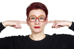Portrait of woman with fingers to her ears Stock Photos