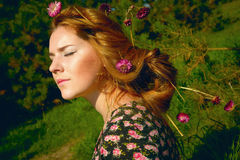 Portrait of woman in fir-tree wood with flowers spring Royalty Free Stock Photo