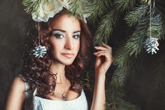 Portrait of a woman among the firs. Royalty Free Stock Image