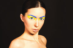 Portrait of a woman. Portrait of a woman with the flag of the Ukraine painted on her face Stock Photos