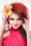 Portrait of woman with flower in hair on white Royalty Free Stock Image