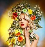 Woman  with flower hairstyle. Stock Images