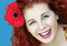 Portrait  woman with a flower. Portrait of red-haired woman with a flower Stock Photos