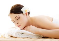 Portrait of a woman with a flower on a spa procedure Royalty Free Stock Photo