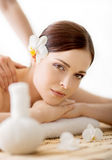 Portrait of a woman with a flower on a spa procedure Royalty Free Stock Image