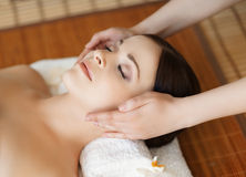 Portrait of a woman with a flower on a spa procedure Royalty Free Stock Images