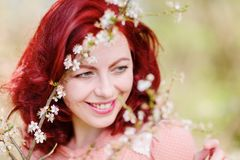 Portrait of a woman in a flowering tree. Portrait of a beautiful woman in a flowering tree Stock Image