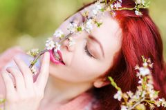 Portrait of a woman in a flowering tree. Portrait of a beautiful woman in a flowering tree Royalty Free Stock Photography